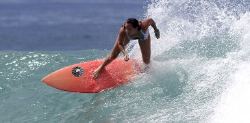 Meryl on her pink zambrana board. Someone stole it. Help us find it!